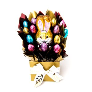 A 150g Old Gold bunny and 13 milk chocolate half eggs surrounded by brown and gold cello in a small gold box.