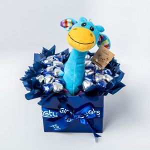 A 30cm blue Gabby Giraffe soft toy and 34 silver and blue foil wrapped milk chocolate hearts surrounded by blue cello in a medium blue box.