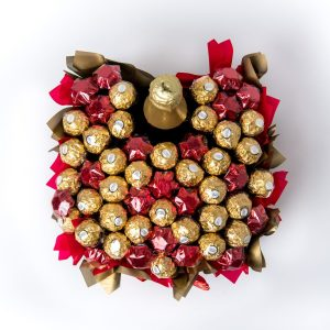 A 750ml Wolf Blass Sparkling Brut NV, 32 Ferrero Rocher chocolates and 20 red foil wrapped milk chocolate stars surrounded by red and gold cello in a large gold box.