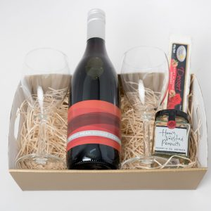 This hamper consists of the following: 1 x 750ml Stony Peak Shiraz Cabernet 2 x Wine glasses 1 x 60g Ogilvie & Co. roasted nuts 1 x 60g Flying Swan nougat