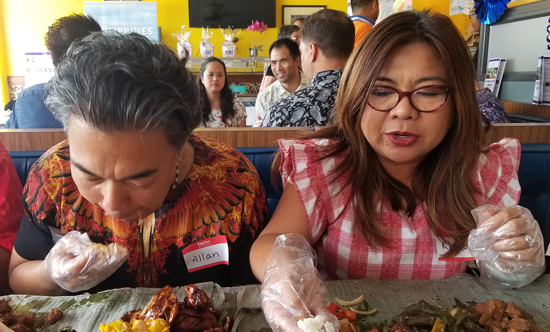 Allan and Rhoda going for it, Kamayan style!