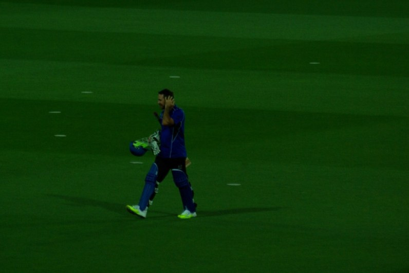 Ricky Ponting walks off the field.