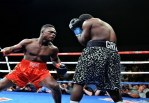 Benin Boxer Collapses after receiving heavy Punch from Ghana's Bastie Samir - Video