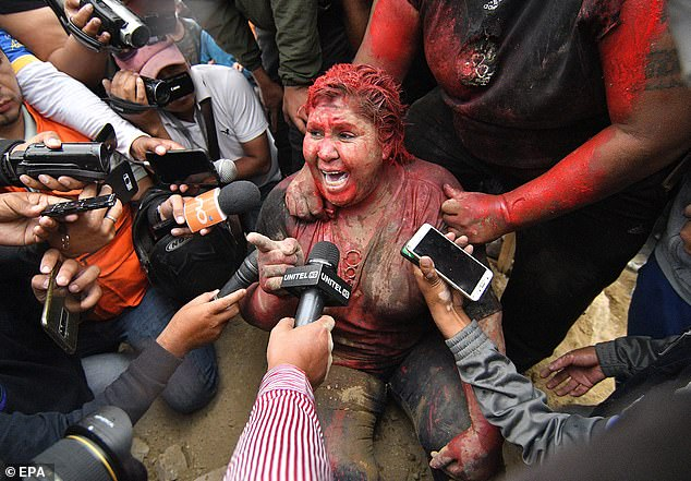 Angry Mob attacks Female Bolivian Mayor with paint, cuts hair