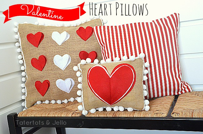 burlap and heart pillows with pom poms