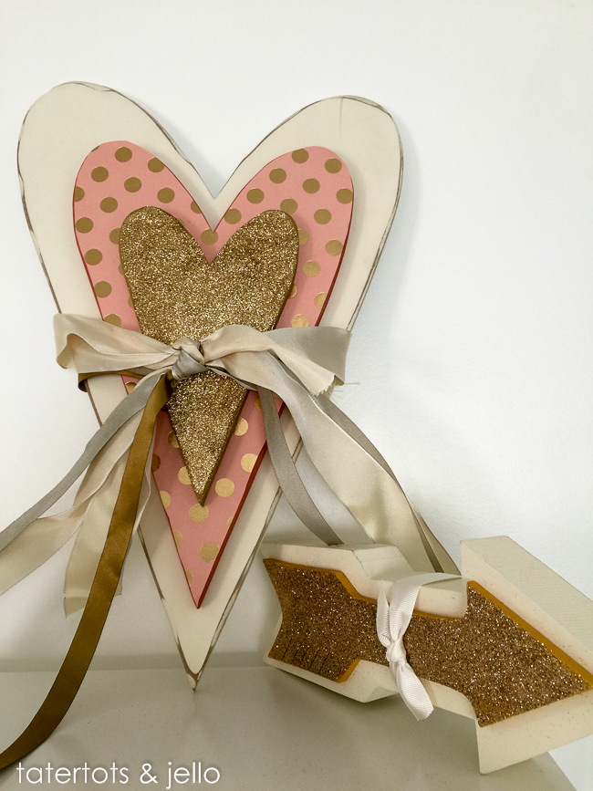 Layered wood heart with scrapbook paper and glitter. DIY tutorial