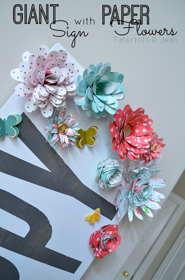 Make a giant sign with paper flowers.