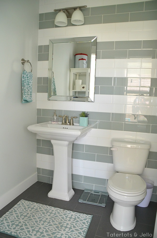 green and white striped tile bathroom