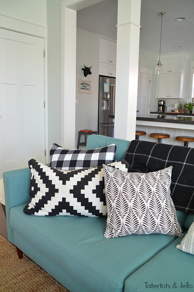 black and white pillows mixing patterns