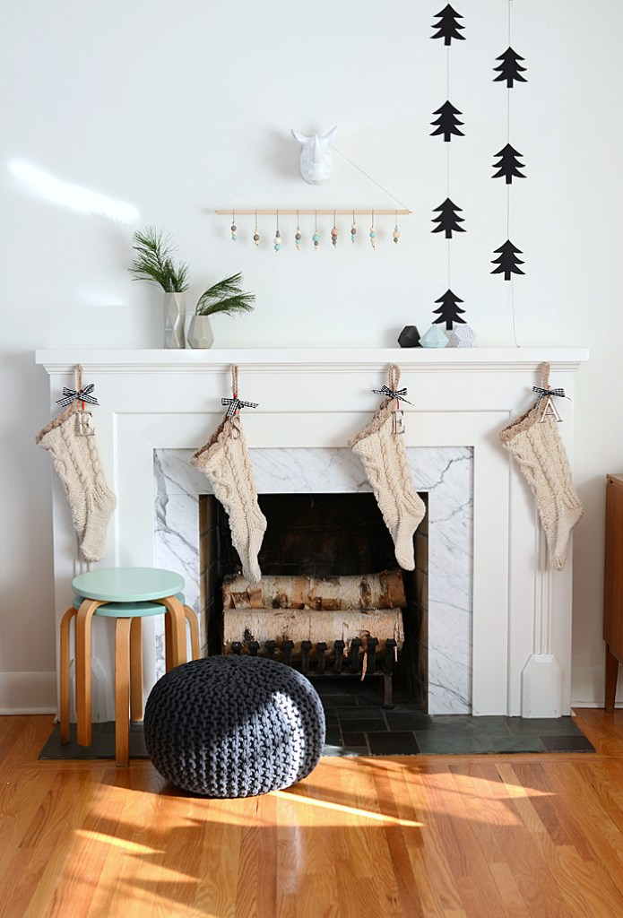Black and White Modern Holiday Mantel. Gorgeous mantel ideas plus over 100 other ways to make the holidays awesome at your house this year!