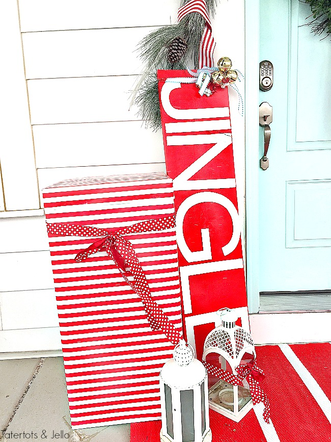 Red and White North Pole Christmas Porch. Many different inexpensive ways to celebrate the season and decorate YOUR outdoor space!