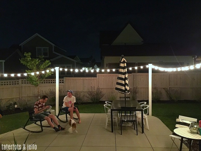 1 hour modern cafe light patio project. Use vinyl fence posts to create a modern way to display cafe lights in your yard.
