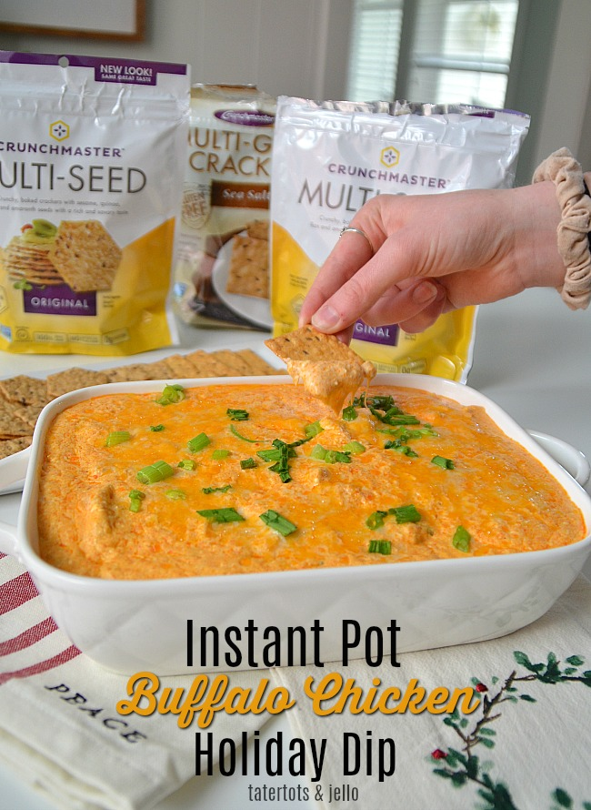 Instant Pot Buffalo Chicken Dip is perfect for the holidays! It only take minutes to make and the spicy flavor contrasts perfectly with Crunchmaster Crackers.