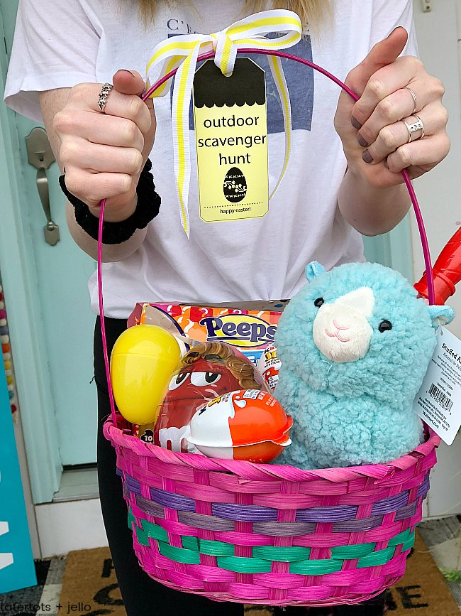 Celebrate Easter with an Outdoor Easter Scavenger Hunt with printable clues! Your kids and teens will love running around the neighborhood solving clues and collecting a basket of super cute treats.
