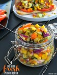 Fresh Pickle Veggie Relish is the perfect topping for your Summer BBQ. Pickles, fresh veggies and a light dressing are all combined to make the perfect topping for your hamburgers, hot dogs and sandwiches this summer!