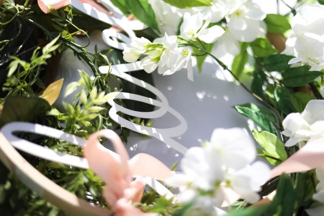 Make a DIY Magnolia Garden Wreath for Summer. All it takes is a few materials and in less than 15 minutes you will have a beautiful wreath to hang on your door or wall!