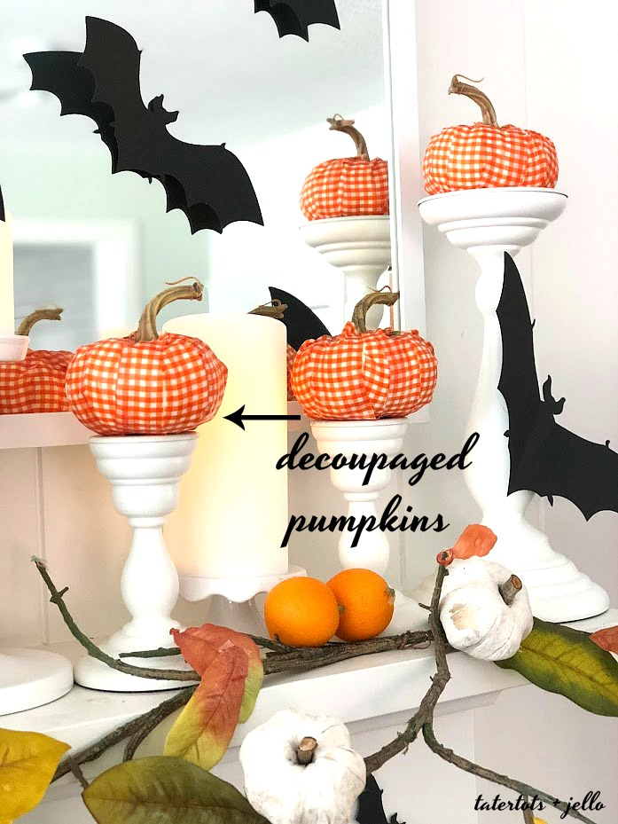 Halloween Bats in an Orange Orchard Mantel. Pumpkins on orange vines, farmhouse signs, decoupaged pumpkins and bats make a bright Halloween mantel with a slightly spooky side!