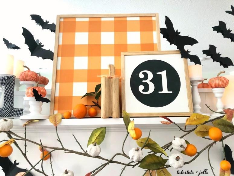 bats flying through an orange orchard halloween mantel