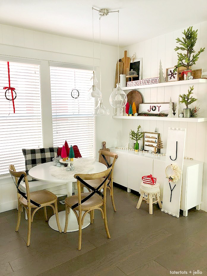 Cozy Christmas Nook Decorating Ideas! Decorate shelves in your kitchen for the holidays with DIY projects, greenery and trees for a welcoming place to gather with your family.