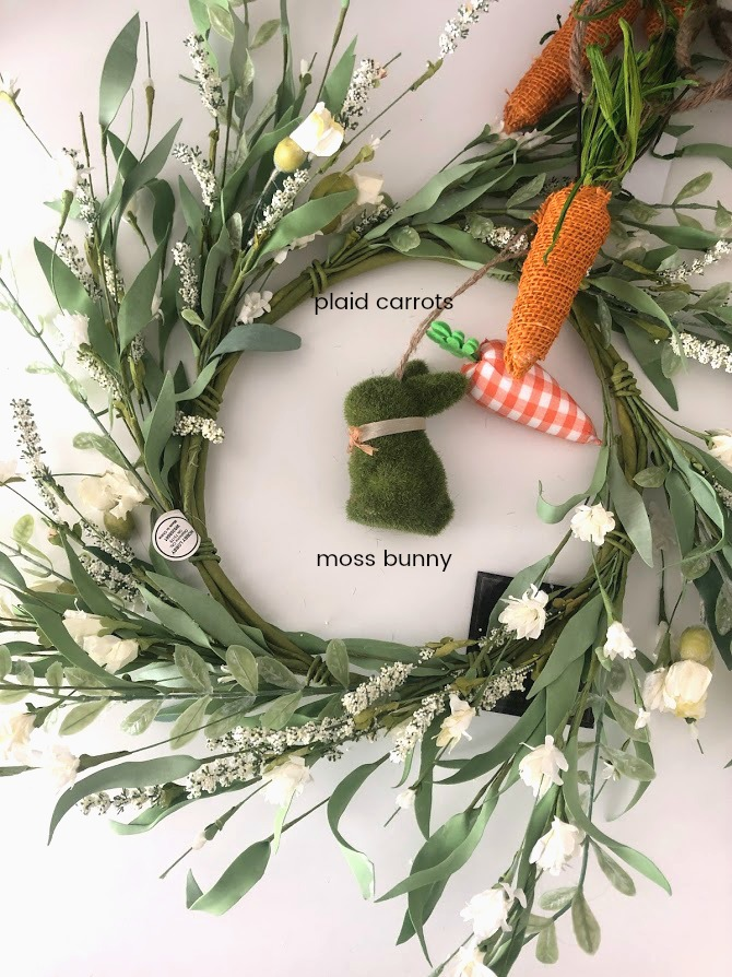 Spring Plaid Carrot Layered Wreath. Layer pretty orange gingham and a pretty floral wreath with a moss bunny and plaid carrots for a wreath that will welcome your guests this Spring!