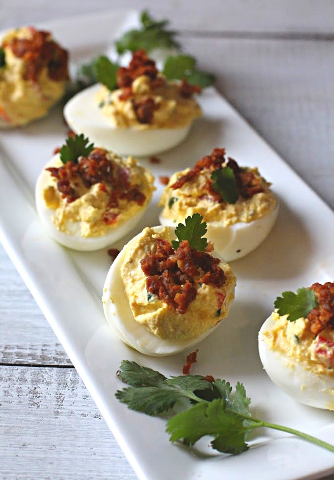 Deviled eggs are a favorite Easter snack at my house. There's so many ways to make them! Here are 16 Deviled Egg Recipes perfect for Easter!