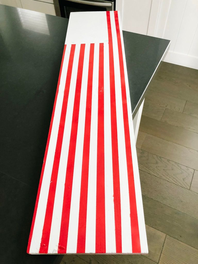Make a GIANT Patriotic Flag Sign. Perfect for Memorial Day, Fourth of July or anytime, this easy sign will make a statement on your porch or inside your home!