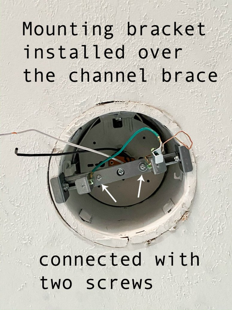 Install the mounting bracket over the channel brace with two screws.
