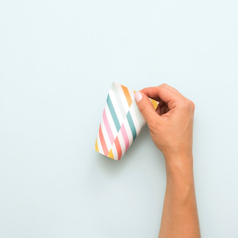 How to Make Simple Paper Candy Cones. Turn a piece of paper into a fun party favor or gift idea in four simple steps!