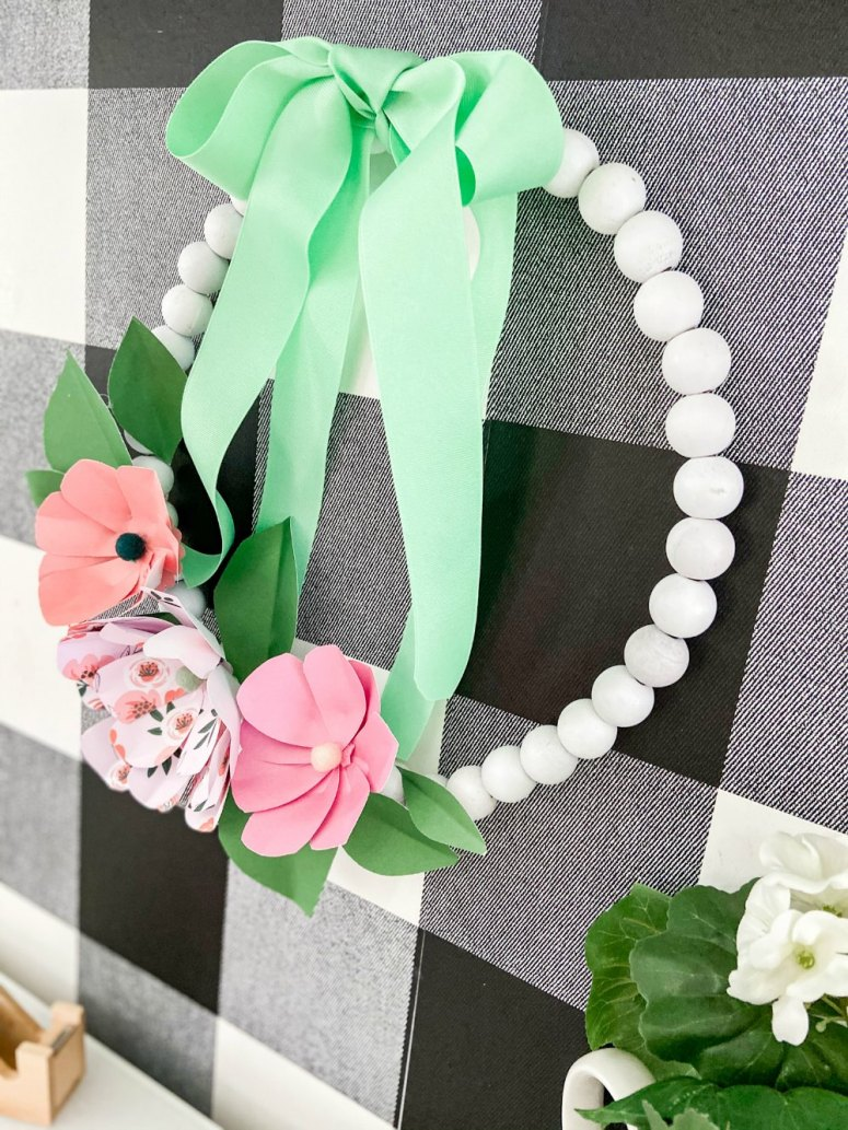 Wood Bead Wreath with Paper Flowers. Make this trendy wood bead wreath and create easy paper flowers with free petal and leaves template!