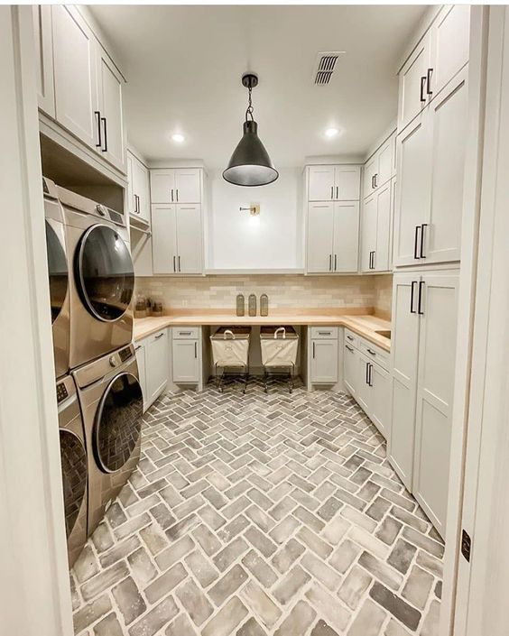brick and neutral laundry room.