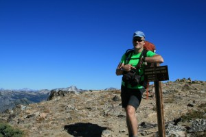 Dave standing at the sign at Switchback Peak