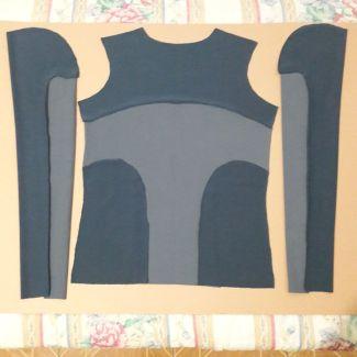 Tecido cortado: frente e mangas