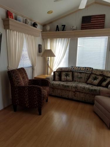 Living room with flat screen TV, sleeper sofa