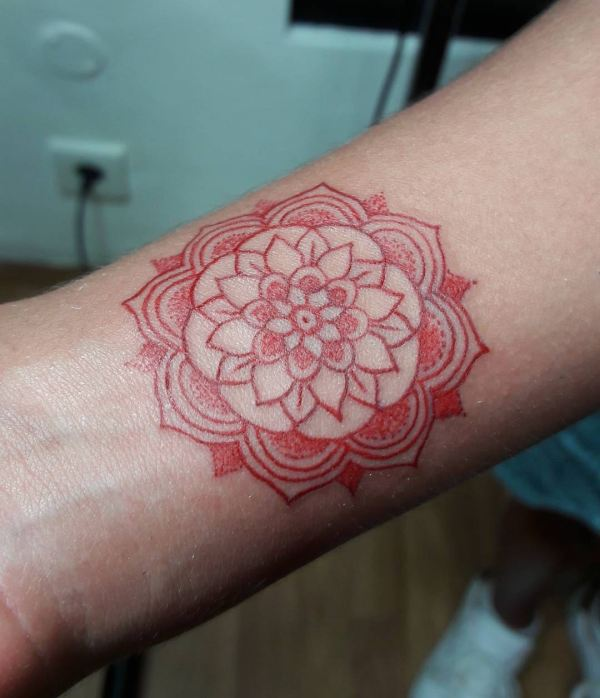 Red mandala tattoo by Indra Nice Art Tattoo