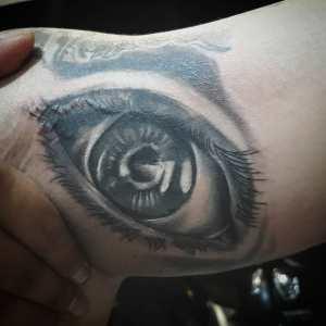 Black and grey eye tattoo by Gendunk13 Bali tattoo artist