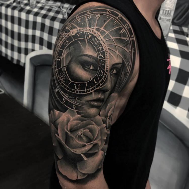 Tattoo portrait on upper arm
