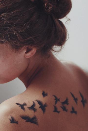 Beautiful birds tattoo