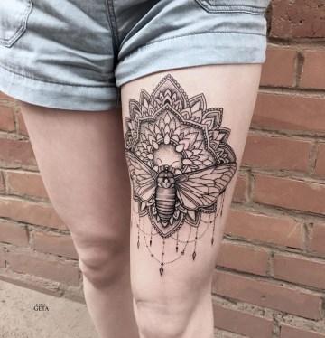 Moth mandala thigh tattoo