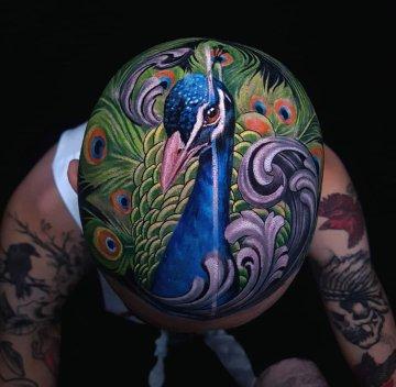 Peacock head tattoo