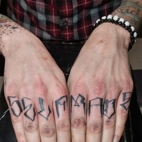 strong knuckle tattoo design