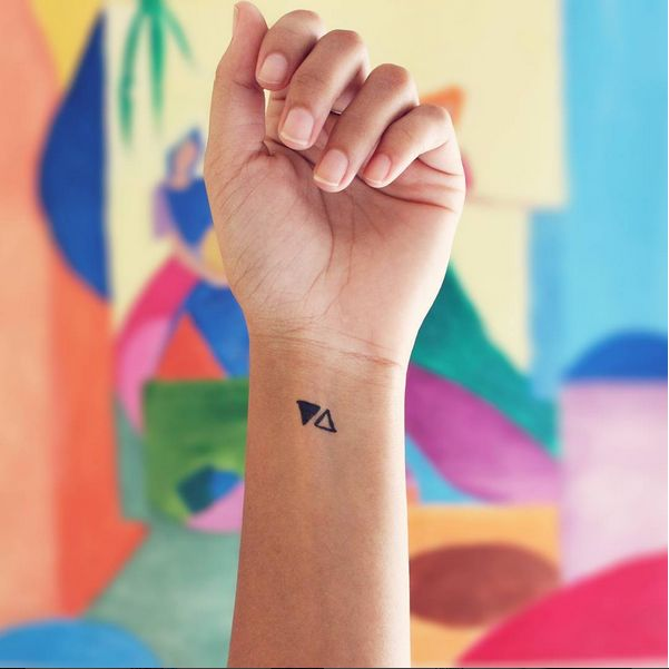little triangles tiny tattoo expose simplicity on wrist