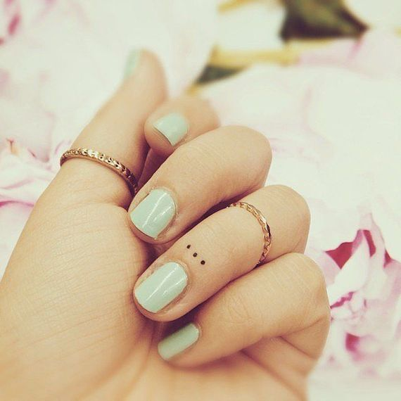 the daintiest of dots tiny tattoo on finger