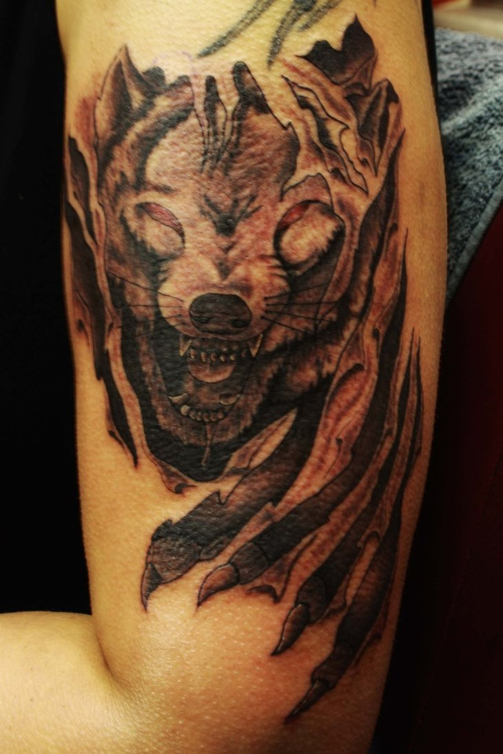 Best tribal wolf tattoo ever