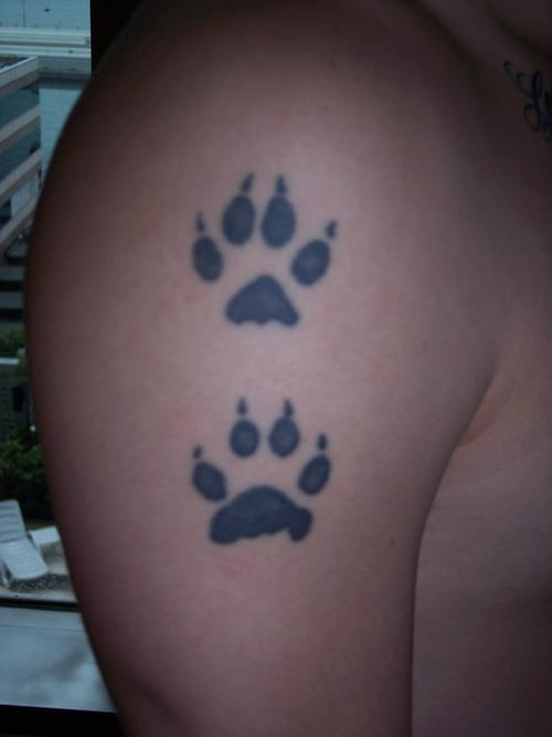 Wolf paw print tattoo on hand