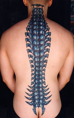 biomech spine bone coloured tattoo