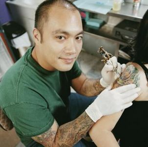 tattoo artist smiling