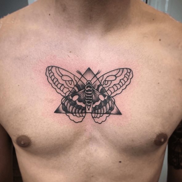 moth chest tattoo