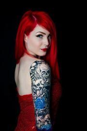 red hair girl tattoo skulls