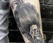 skeleton with big hair tattoo