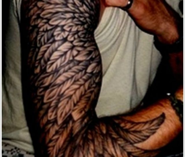 Cool Looking Feather Mens Arm Tattoo